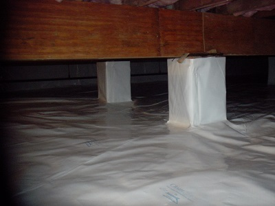 Installation of 20 mil-thick vapor barrier to stop moisture intrusion